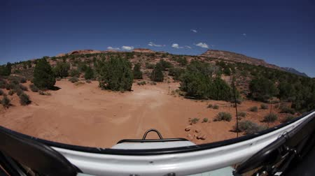 rocks red : Traveling probe view of the beautiful Moab scenery, shot from the front of a jeep. Stock Footage