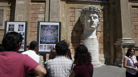 augustus : Footage behind tourists looking at Head of Augustus.