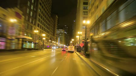 pole street : Shot of car traveling in traffic in downtown Chicago at night.