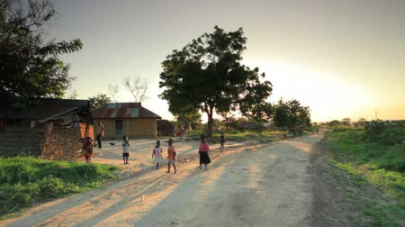 deprived : Shot of children playing in the dirt roads in Kenya, Africa. Stock Footage