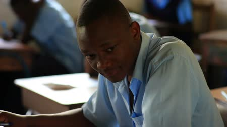 concentrando : Front view of school boy in class in Kenya, Africa.