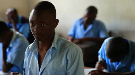 ödev : Front view of school boy in class in Kenya, Africa.