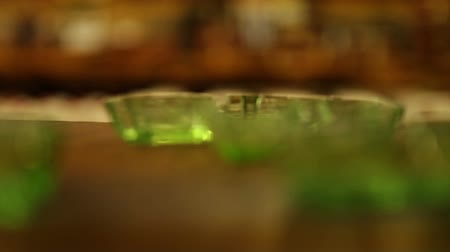 suvenýry : Steady shot focusing in and out on a set of decorative glass ash trays. California