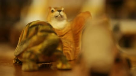 toad : Inside a gift shop. Detail shot of a carved frog, squirrel, and turtle. California Stock Footage