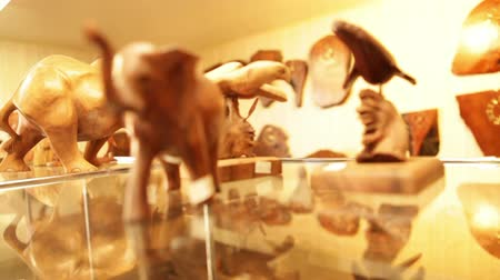 bugiganga : Shot of a gift shop display in. Elephant trinkets and a carved seal. California