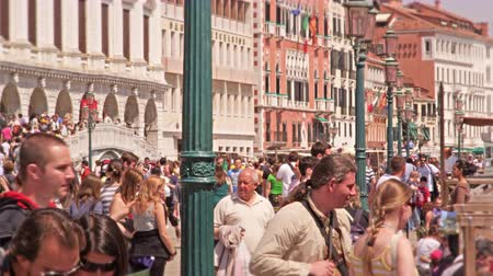 congested : A slow motion shot as crowds file over Ponte de Sospini next to the Grand Canal entrance.  Old Italian buildings are seen lining the walkway.  Shot With a high speed camera on May 2,2012 in Venice,Italy Stock Footage