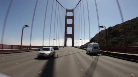 barışçı : Moving shot, driving across the Golden Gate Bridge. San Francisco, California. Stok Video