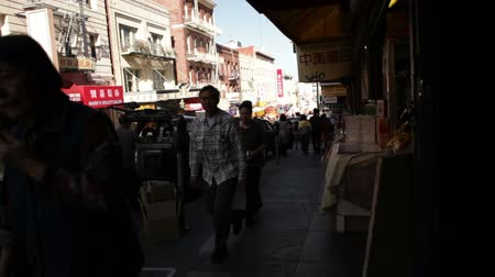 erkély : Steady shot as people walk past on the sidewalk, in Chinatown. California Stock mozgókép
