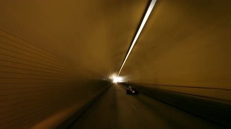 subterranean : Driving through a round tunnel in Chinatown. California Stock Footage
