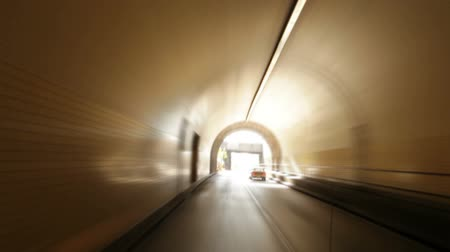 underground tunnel : Moving shot of driving through a tunnel and into the city. California Stock Footage