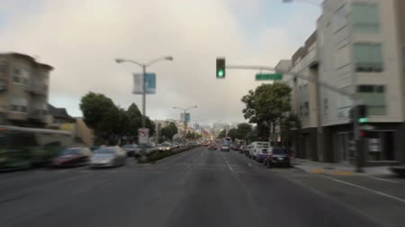 pole street : Moving shot driving down a nearly empty street downtown. California Stock Footage