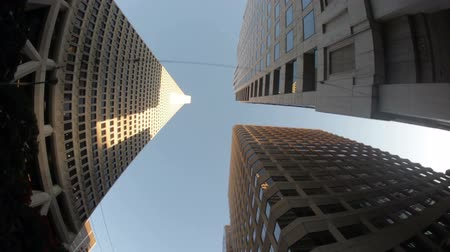 имущество : Moving shot, looking up from the base of several skyscrapers. California
