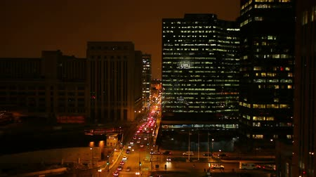 converge : Aerial shot of a street in downtown Chicago at night. Stock Footage