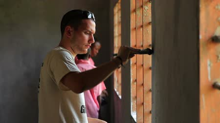 kmenový : Painting the interior of a school in a village in Kenya two hours north of the Africa city Mombassa.
