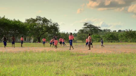 horas : Boys playing during recess near a village in Kenya two hours north of the Africa city Mombassa.