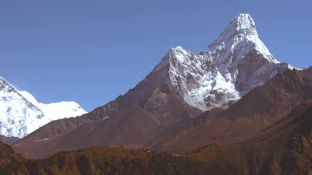 nuptse : A panoramic shot of the mountain Ama Dablam and Lhotse in the Himalaya. Everest is hidden.