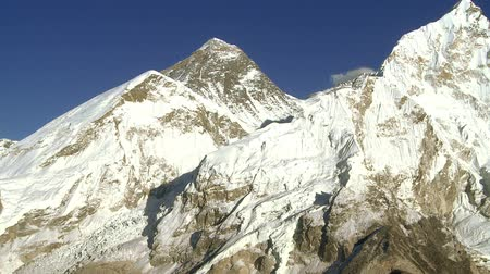 nuptse : A shot showing Mount Everest and nearby peaks Lhotse and Nuptse. Stock Footage