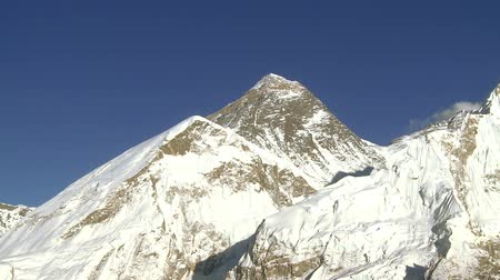 nuptse : A panoramic shot showing Mount Everest and nearby peaks Lhotse and Nuptse. Stock Footage