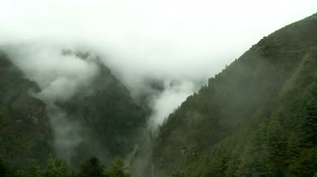birincil : mountains shrouded in mist and clouds