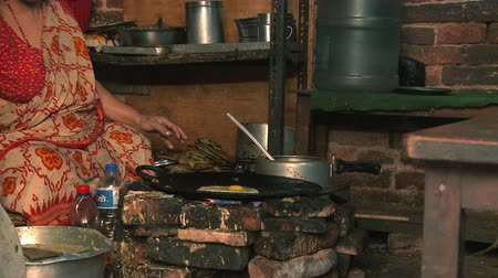 tikka : Nepali woman cooking authentic Nepali food Stock Footage