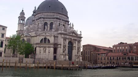 festa : Tracking footage of the Santa Maria della Salute basilica in Venice,from a canal water taxi. Filmed on May 2,2012