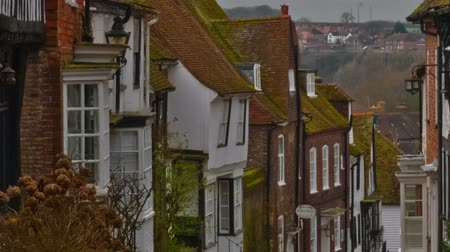 falu : Timelapse shot of Mermaid Street in Rye, East Sussex. The shot shows a cobbled street, cottages and some people. Panning shot.