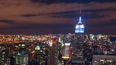 imparatorluk : New York cityscape time-lapse from the Rockefeller building. The Chrysler and Empire State Buildings are visible. Shot in New York City, USA. Cropped. Stok Video