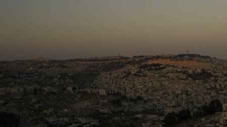 wailing : Sunset from behind shot of Jerusalem. Panning shot.