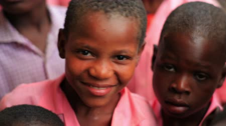 download : Kids smiling into the camera in Kenya, Africa.