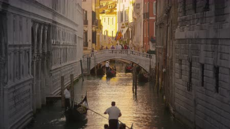 veneza : Shot of several gondolas in a canal with a bridge. Shot in Venice,Italy