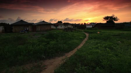 gramado : Huts at sunset near Mombassa. Stock Footage