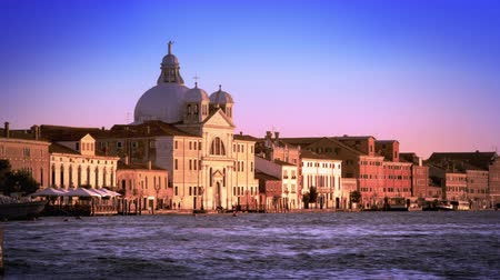 запутанный : A slow motion,panning shot of the Bauer Palladio Hotel across the waterway. Includes a floating building. Shot in the daytime with a high speed camera on May 3,2012 in Venice,Italy