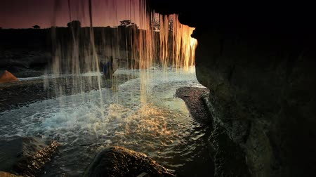 descobrir : Inside shot of a waterfall at sunset in Kenya, Africa.