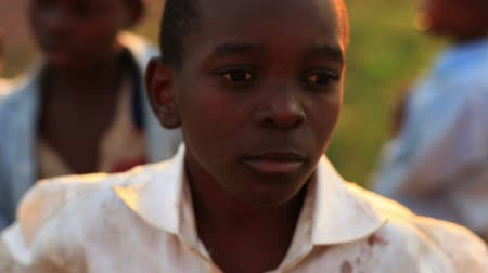 humanidade : Boys look at camera in Africa