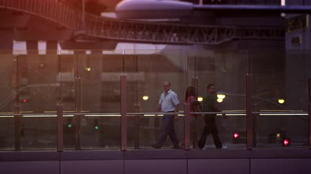 bolsa : Static shot of people walking inside in vegas. Women have purses.Filmed on September 13 2012.