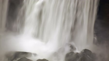fall down : Bottom of the America Falls. Water is crashing down on rocks.