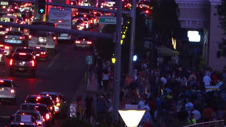 asfalt : HIgh-angle footage above a street crowded with cars and a sidewalk crowded with people in Las Vegas,Nevada