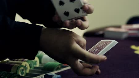 patins : Fanning cards out onto the table and pulling the aces from the deck.