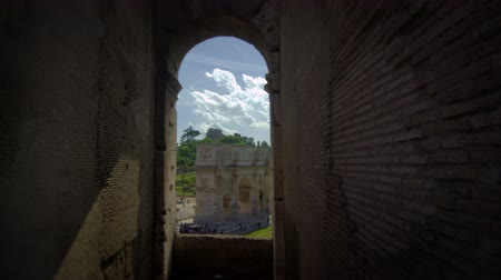arch of constantine : The Arch of Constantine is visible through an arched window in the Colosseum. The shot is very dark except for the view of the Arch. Shot on May 6,2012 in Rome,Italy