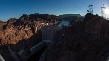 gerador : Timelapse shot of the sunrise over the Hoover Dam in Nevada with lens flare