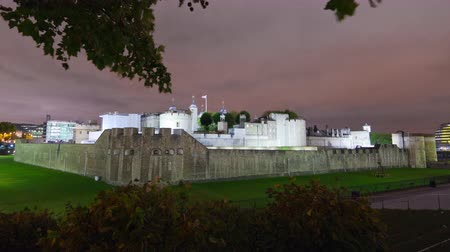 old dungeons : Time-lapse distant shot in the evening of the Tower of London in London, England. Filmed in October 2011.