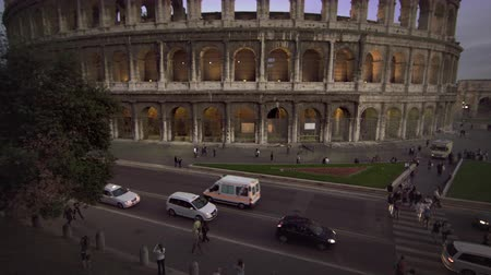 amphitheatre : Footage of vehicles on the street next to the northwest corner of the Colosseums exterior,including the arch of Constantine. Filmed in Rome,Italy on May 6,2012