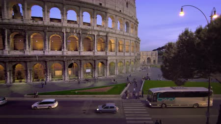 arch of constantine : Footage of vehicles on the street next to the northwest corner of the Colosseums exterior,including the arch of Constantine. Filmed in Rome,Italy on May 6,2012