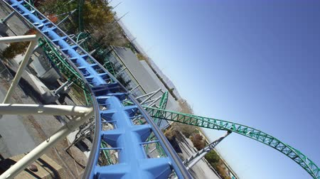 rolete : First person view of a roller coaster riding the peaks and slopes of the track.