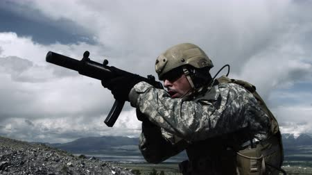 asker : Close up of a soldier with sub-machine gun down, aiming, firing, and lowering weapon. Green Beret United States Army Special Forces. Stok Video