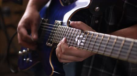 şarkı : View of hands playing electric guitar. Stok Video