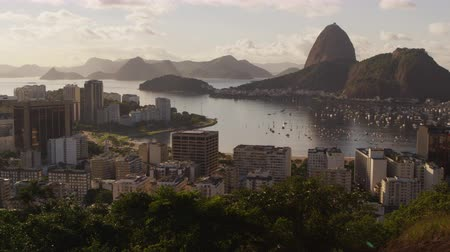 sugar loaf : Pan shot of Rio de Janeiro and the Ocean. The footage reveals downtown Rio, Sugarloaf Mountain and its neighboring mountains, the winding avenues of the city, and Guanabara Bay.