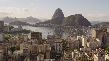 sugar loaf : Daylight shot of Rio de Janeiro and traffic on the ocean avenue. Stock Footage