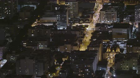 high speed road : Time-lapse shot of downtown Rio De Janeiro at night, traffic driving down main avenue of city center