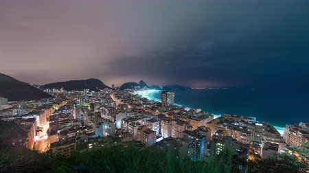 sugar loaf : Time lapse atop a mountain of a coast in Rio de Janeiro, Brazil. Sugar Loaf can be seen in the background.